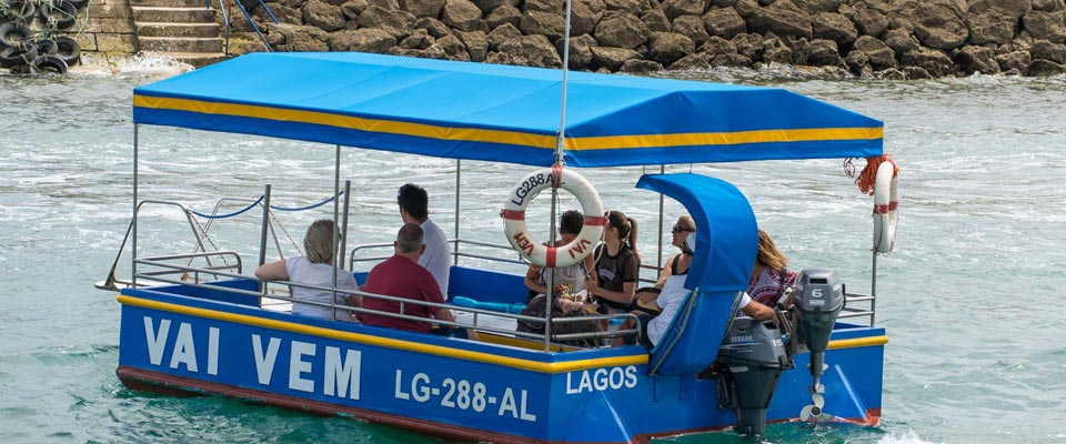 "Small passenger ferry, ""Vai Vem"", that can take you to Meia Praia"